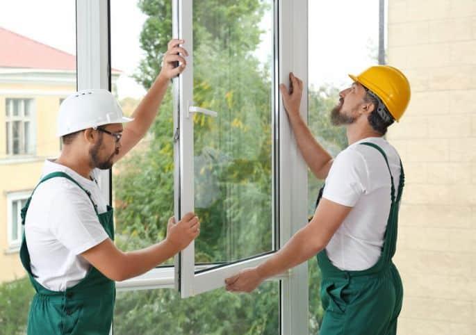 Picture of contractors replacing windows.